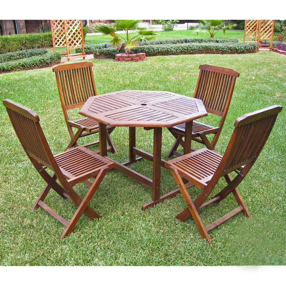 stow away wooden table with 4 folding chairs in patio. Black Bedroom Furniture Sets. Home Design Ideas