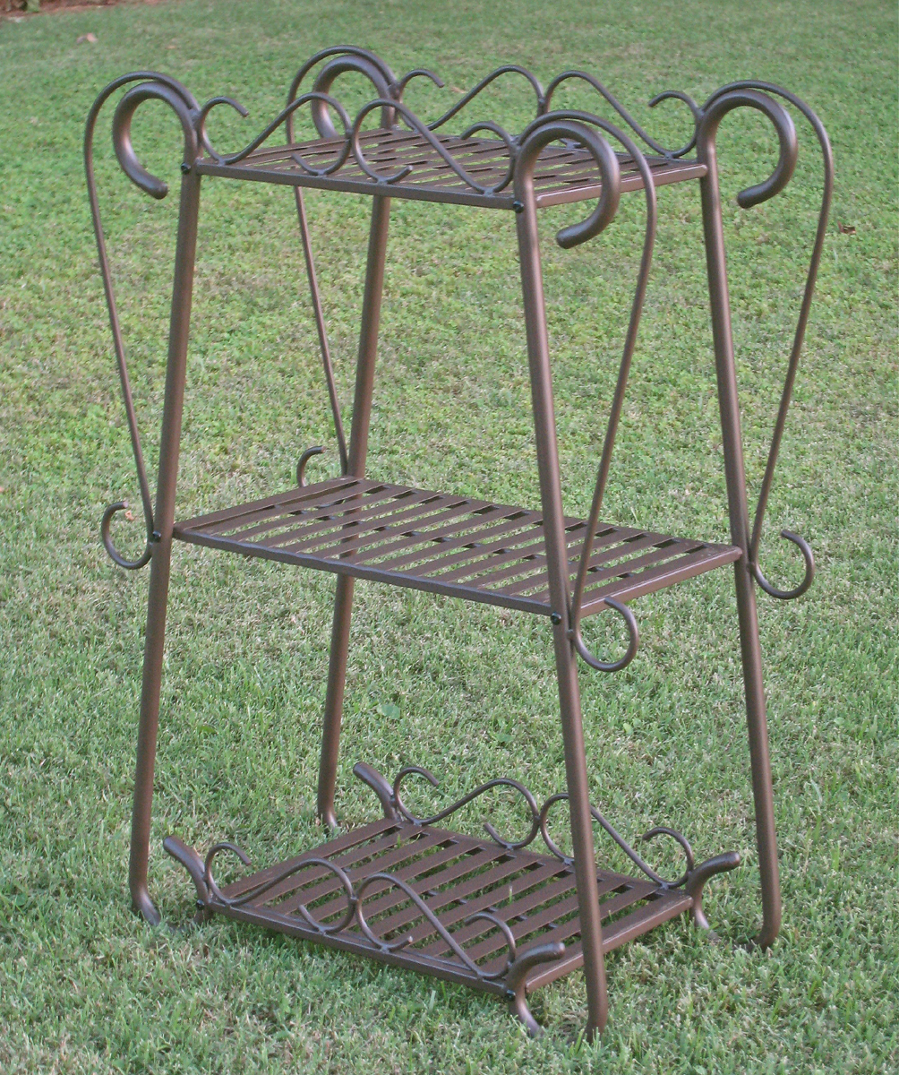 Iron Three Tier Plant Stand In Garden Plant Stands